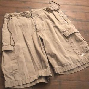 NIKE size medium khaki shorts, with drawstring.